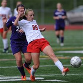 Peters Township's Mia Toscano controls the ball in front of  Baldwin's Allison Breisinger during a WPIAL Class AAA girls soccer first-round playoff game Saturday.