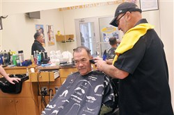 The $6 million Post Exchange for military families and veterans that opened along with the new Pittsburgh Area Commissary in Moon has a two-chair barber shop for military haircuts. Barber Jeff Michel, a Vietnam-era Army veteran, cuts the hair of Tom Carter, from Beaver Falls, an Air Force veteran who fought in Vietnam.