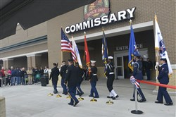 The honor guard marches in  front of the new Commissary  during the grand opening ceremony in Moon Township.