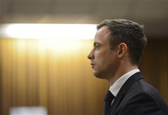 South African Olympic and Paralympic track star Oscar Pistorius stands as his sentence is delivered this morning at the North Gauteng High Court in Pretoria.