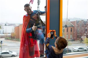 Window washer Ed Hetrick, dressed as Superman, poses for Douglas Mitchell, 3, of Baden at Children's Hospital of Pittsburgh of UPMC in Lawrenceville.