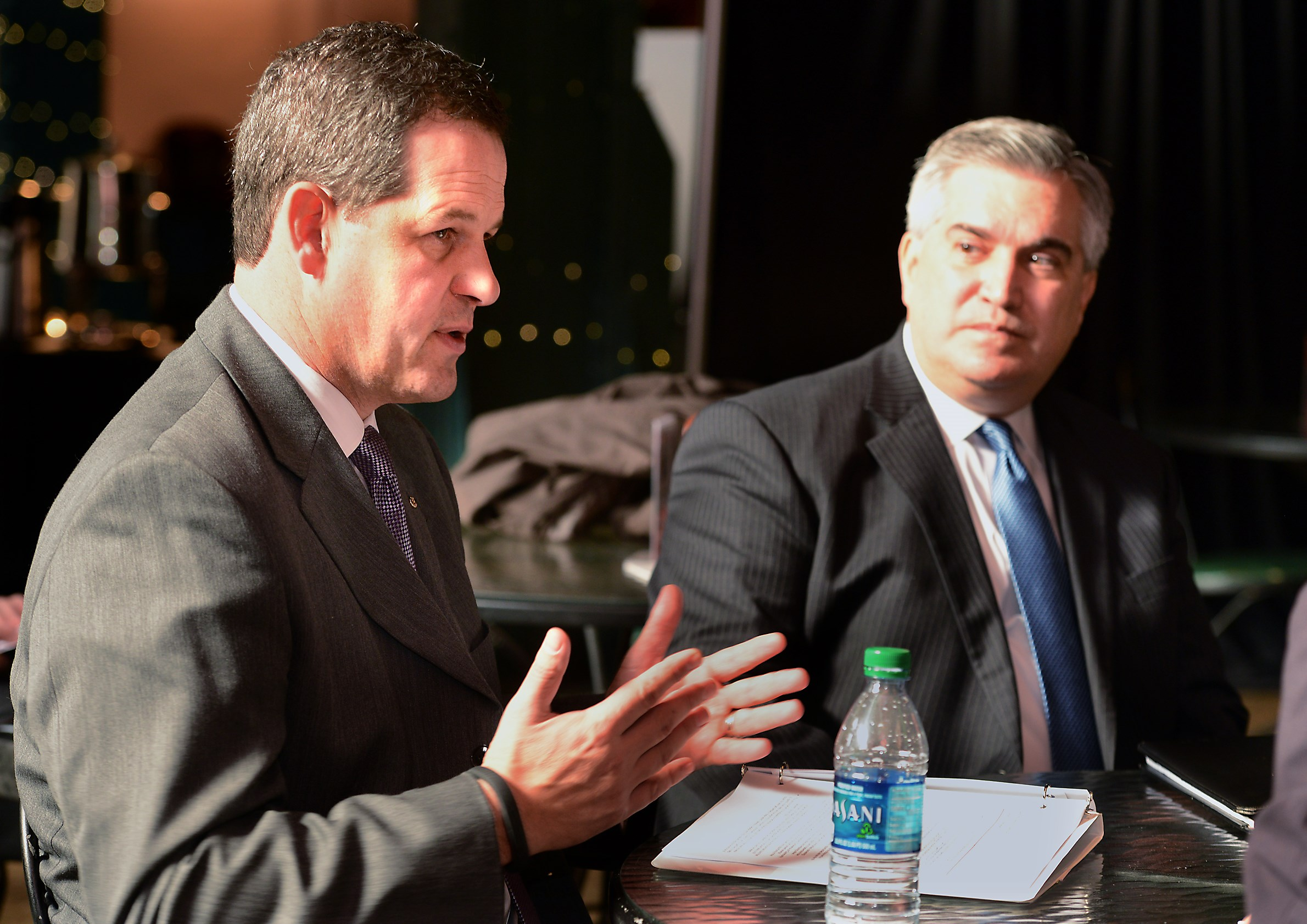 From left, Nigel Hearne, president of Chevron Appalachia, and Trip Oliver, also of Chevron, talk with the media following a news conference at the Sen. John Heinz History Center in the Strip District. The two were part of a panel announcing the Appalachia Partnership Initiative from the Chevron Corp.