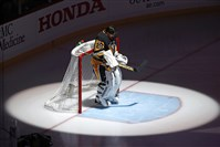 Penguins goalie Marc-Andre Fleury stands in front of his goal during the playing of the Canadian national anthem before Thursday's game against the Flyers. Gene J. Puskar