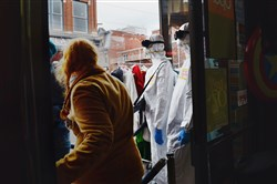 "Customers walk past mannequins wearing ""white survival suits,"" one of this year's most popular Halloween costumes in the wake of the Ebola crisis, on Oct. 18 at Spotlight Costumes on the South Side."