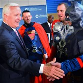 Gov. Tom Corbett greets superheroes, from left, Ed Hetrick, Steve Virag and Jim Zaremba after announcing a $2.5 million state grant for Children's Hospital of Pittsburgh of UPMC in Lawrenceville. The superheroes are window cleaners from the Allegheny Window Cleaning.