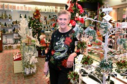 Judy Morini in her Christmas Corner store at The Mall at Robinson.  Ms. Morini has trouble finding reliable help for her store.