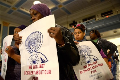 Melanie Carter of Homewood attends a town hall event Tuesday night at Pittsburgh Westinghouse Academy with a group decrying violence against women in the community.