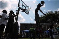 Mazzy Bailey, then 17, of Bedford Dwellings in the Hill District, goes in for a dunk in 2012 at a lowered rim during events at the Bedford Dwellings Community Day as organized by the Housing Authority. The authority won't release its findings from an investigation into tenant council elections at the housing complex.