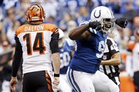 Indianapolis Colts defensive end Cory Redding, right, celebrates after sacking Cincinnati Bengals quarterback Andy Dalton during the first half of a game Sunday, Oct. 19, 2014, in Indianapolis.