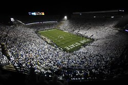 "In this Sept. 26, 2009, file photo, Penn State fans wear white as they fill Beaver Stadium to show their support for the Nittany Lions as they face Iowa in an NCAA football game in State College, Pa. Penn State asked all of their fans to wear white in support of their ""White-Out"" slogan for the game."