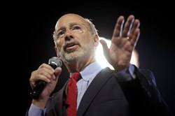 Gov.-elect Tom Wolf takes the stage at his primary election party in Santander Stadium in York, Pa.