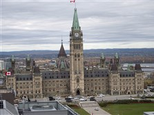 Police surround Parliament Hill in Ottawa Wednesday after at least one gunman killed a soldier standing guard at the National War Memorial and then ran into parliament.