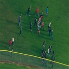 This image made from a video provided by KOMO shows students walking as emergency personnel respond to the sce