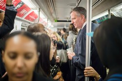 Mayor Bill de Blasio takes the subway Friday on his route to City Hall in New York City.