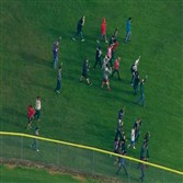 This image made from a video provided by KOMO shows students walking as emergency personnel respond to the scene of a shooting at Marysville-Pilchuck High School in Marysville, Wash., on Friday.