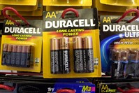 Duracell batteries hang from hooks on display at an office supply store in Boston.The Procter & Gambl