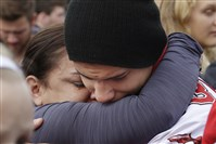 Students comfort each other at a church Friday, Oct. 24, 2014, where students were taken to reunite with parents following a shooting at Marysville Pilchuck High School in Marysville, Wash.