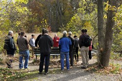 David Drake, Associate Professor and Extension Wildlife Specialist at the University of Wisconsin, Madison, stands next to Nine Mile Run in Frick Park as he addresses a traveling workshop from the Wildlife Society's annual conference in Pittsburgh.