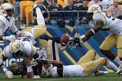 Georgia Tech's Adrian Gardner reaches to recover a fumble by Pitt quarterback Chad Voytik in the first quarter Saturday afternoon at Heinz Field.