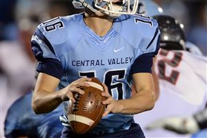 Central Valley quarterback John George drops back to pass against West Allegheny in the first half at Central Valley High School in Monaca.