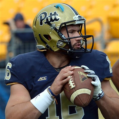 Pitt quarterback Chad Voytik warms up with the new Pitt script on his helmet before the start of his team's game against Georgia Tech Saturday afternoon.