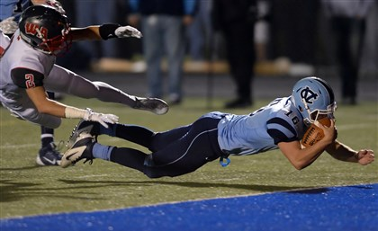 Central Valley's quarterback John George dives into the end zone for a touchdown against West Allegheny's Tyler Scanlon in the first half. Follow Varsity Xtra blog for live updates on HS football night. Check out final scores as they come in.