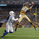 Steelers' Martavis Bryant pulls in a touchdown pass as he's defended by th