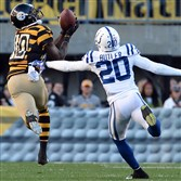 Steelers receiver Martavis Bryant pulls in a pass as he's defended by the Colts' Darius Butler in the second quarter against the Colts Sunday afternoon at Heinz Field.