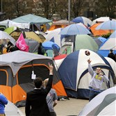 A tent city forms as students gather Thursday in preparation for the ESPN Game Day show at  Mountainlair Green on the campus of West Virginia University in Morgantown.