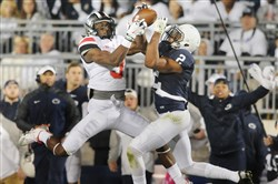 Penn State safety Marcus Allen breaks up the catch of Ohio State s Michael  Thomas during PSU s 379407e62