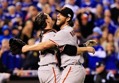 Buster Posey, left, and Madison Bumgarner of the San Francisco Giants celebrate after defeating the Kansas City Royals to win Game 7 of the 2014 World Series Wednesday night.