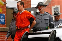 Eric Frein is escorted by police into the Pike County Courthouse for his arraignment in Milford, Pa., this morning.
