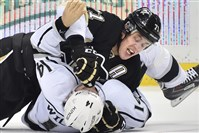 Penguins forward Evgeni Malkin throws a punch at Kings winger Justin Williams in the third period at Consol Energy Center.