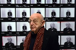 "Standing in front of an enlarged contact sheet of his negatives from a portrait session with Andy Warhol, photographer Duane Michals speaks at an Oct. 31 press preview of his show ""Storyteller: The Photographs of Duane Michals,"" at the Carnegie Museum of Art."