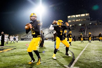Montour's Mason Schrenker and Randall Labrie warm up before their playoff game against Mars at Montour High School Friday night.