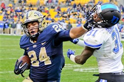 Pitt running back James Conner stiff arms Duke's Breon Borders in the fourth quarter at Heinz Field on Saturday, November 1, 2014. Conner ran for 263 yards and scores 3 touchdowns, but Duke won 51-48 in double overtime.
