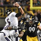 James Harrison pressures Ravens quarterback Joe Flacco in the first half Sunday night at Heinz Field.