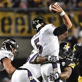 James Harrison pressures Raven quarterback Joe Flacco in the first half of a game in November at Heinz Field.