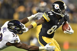 Steelers' Antonio Brown picks up a first down against the Baltimore Ravens at Heinz Field Sunday night.