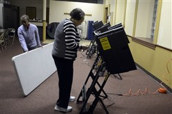 Gail Manker of Summer Hill and Betty Greer of the North Side prepare for voters in November's election.