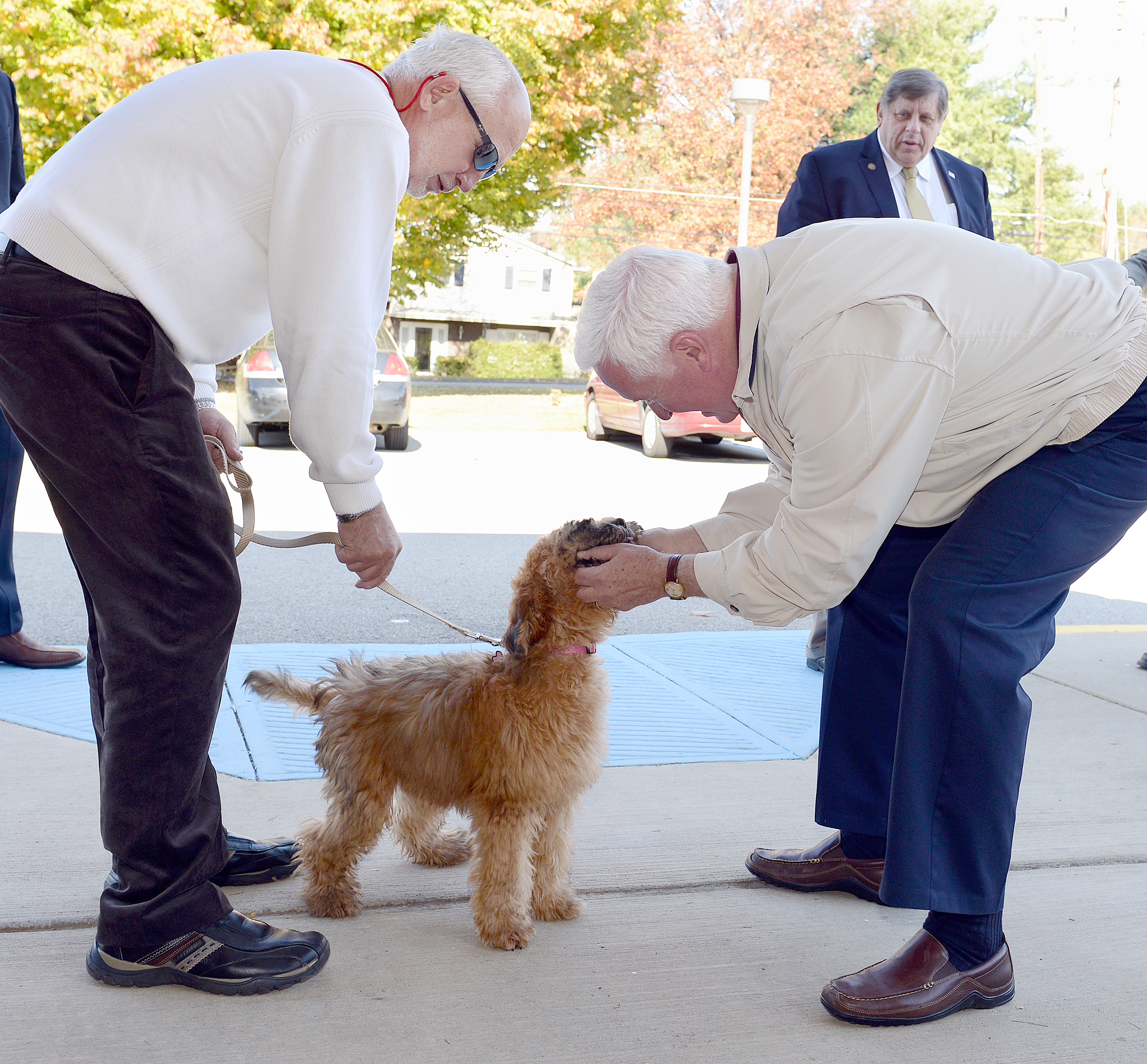 20141104radCorbettCampaignsLocal03-2 Marcee, a Wheaton terrier, meets then-Gov. Tom Corbett with her owner, Fred Orehowsky, on Election Day in 2014.