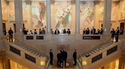 Bill and Scott Meoni-Ridebour say their vows to each other on the Grand Staircase in the Carnegie Museum of Natural History.