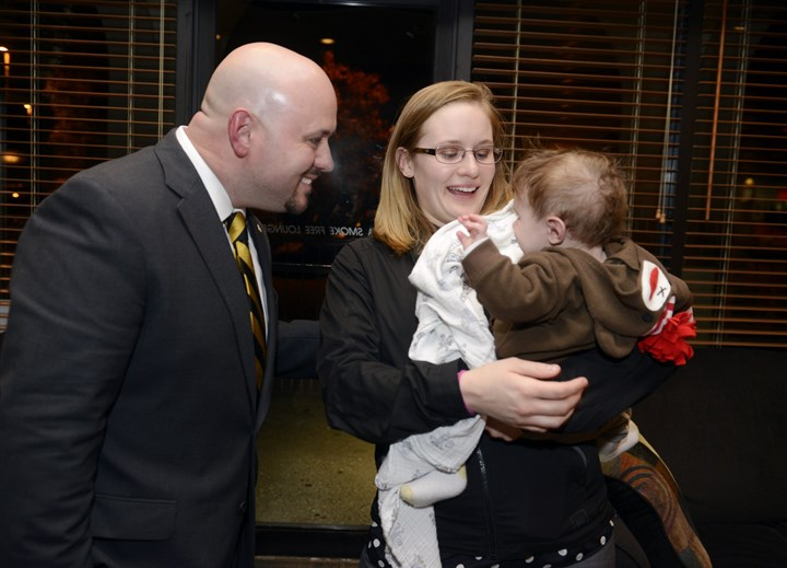 20141104bwWhiteLocal03-2 Jesse White, D-Cecil, with his wife Eileen and son Atticus, 4 months, after speaking to supporters at Burgh's Pizza Wing Pub in Bridgeville and conceding to Jason Ortitay of South Fayette.
