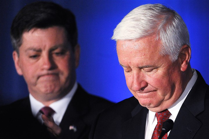 20141104rldCorbettConcedes03-8 Gov. Tom Corbett, right, concedes the election to challenger Tom Wolf on Tuesday as Lt. Gov. Jim Cawley, left, looks on.