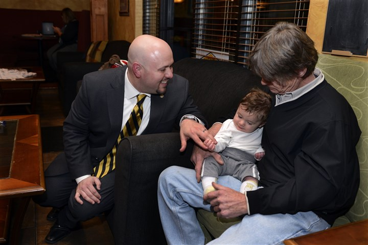 20141104bwWhiteLocal02-1 Jesse White, D-Cecil, with his fatther Jeff White, and son Atticus, 4 months, after speaking to supporters at Burgh's Pizza Wing Pub in Bridgeville.