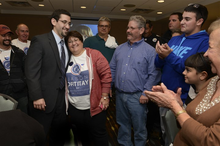20141104bwJasonLocal01 Jason Ortitay, center, of South Fayette, getting a hug from his mother Joann Ortitay with his father watching, left to right, as he wins in the 46th state House district race against Rep. Jesse White, D-Cecil.