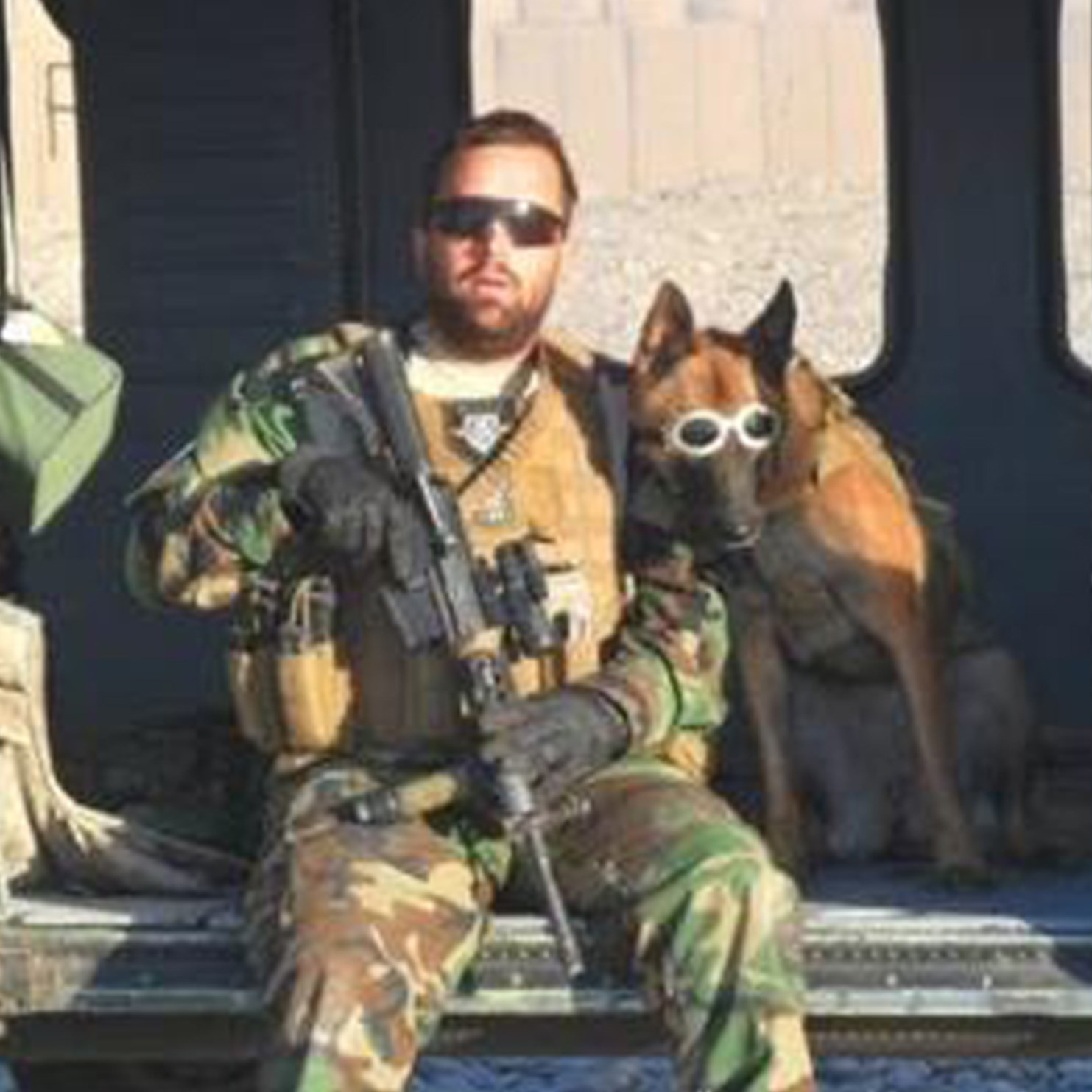 U.S. Army Staff Sgt. James Harrington while on duty overseas with Ryky. The veteran and the Belgian Malnois were reunited after a two-year separation and will participate in New York's Veterans Day parade Tuesday.