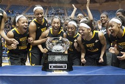 West Virginia's women's basketball team celebrates a share of the Big 12 Conference championship last season after defeating Kansas during a game Tuesday, March 4, 2014, in Morgantown, W.Va. West Virginia won 67-60.