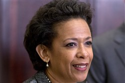U.S. Attorney Loretta Lynch pauses as she speaks in the Roosevelt Room of the White House in Washington on Saturday, when President Barack Obama announced that he will nominate her to replace Eric Holder as attorney general.