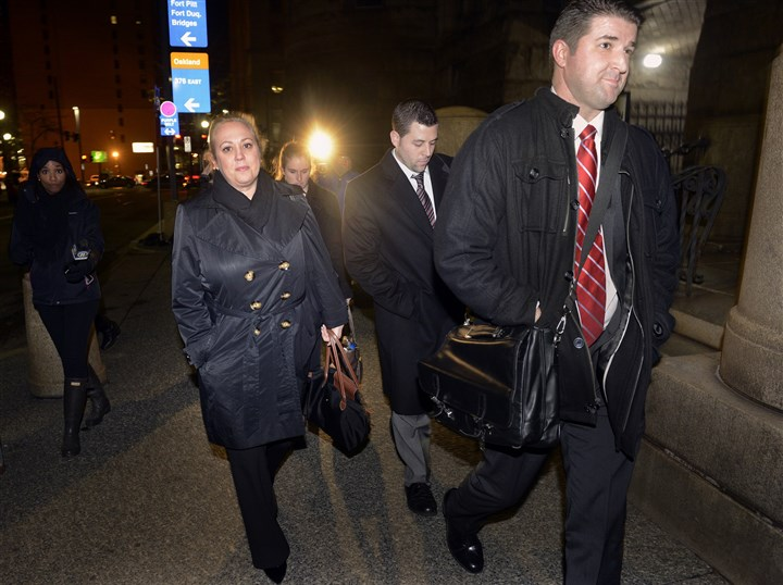 20101107bwTrialLocal02-1 Allegheny County assistant district attorney Lisa Pellegrini, left, leaves the courthouse after winning a guilty verdict in the murder trial of Robert Ferrante. Assistant district attorney Kevin Chernosky is at the far right.